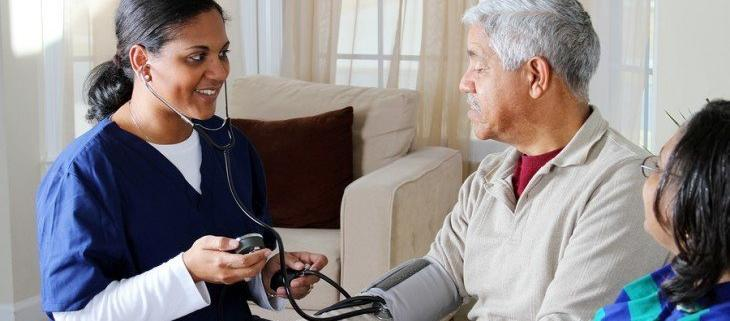 a home health aid caring for a patient